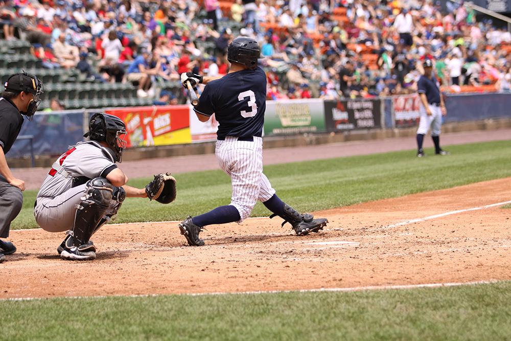 Athlete up to bat at a Sports Facilities Advisory client stadium