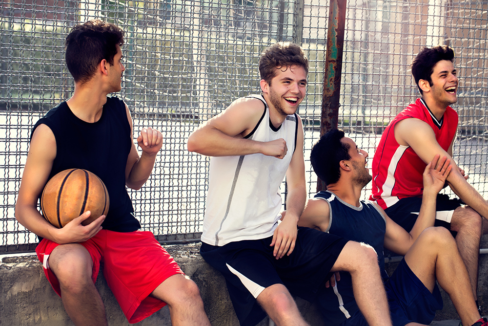 male basketball players chillax at their local sports complex