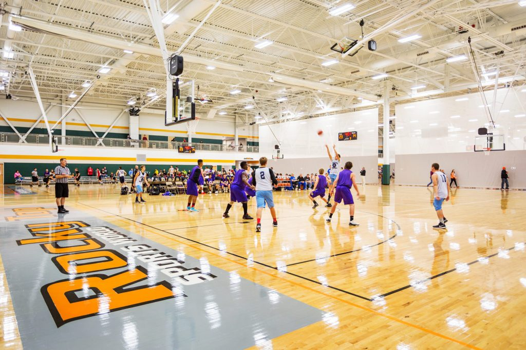 Boys compete in a basketball game at Rocky Top sports complex