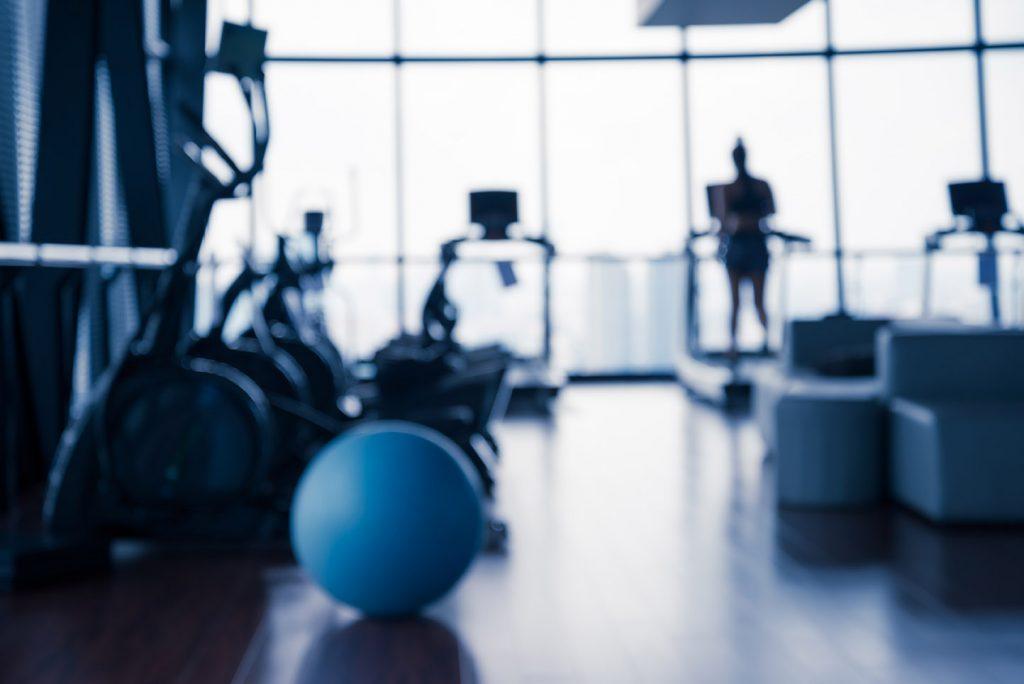woman on treadmill in recreation center