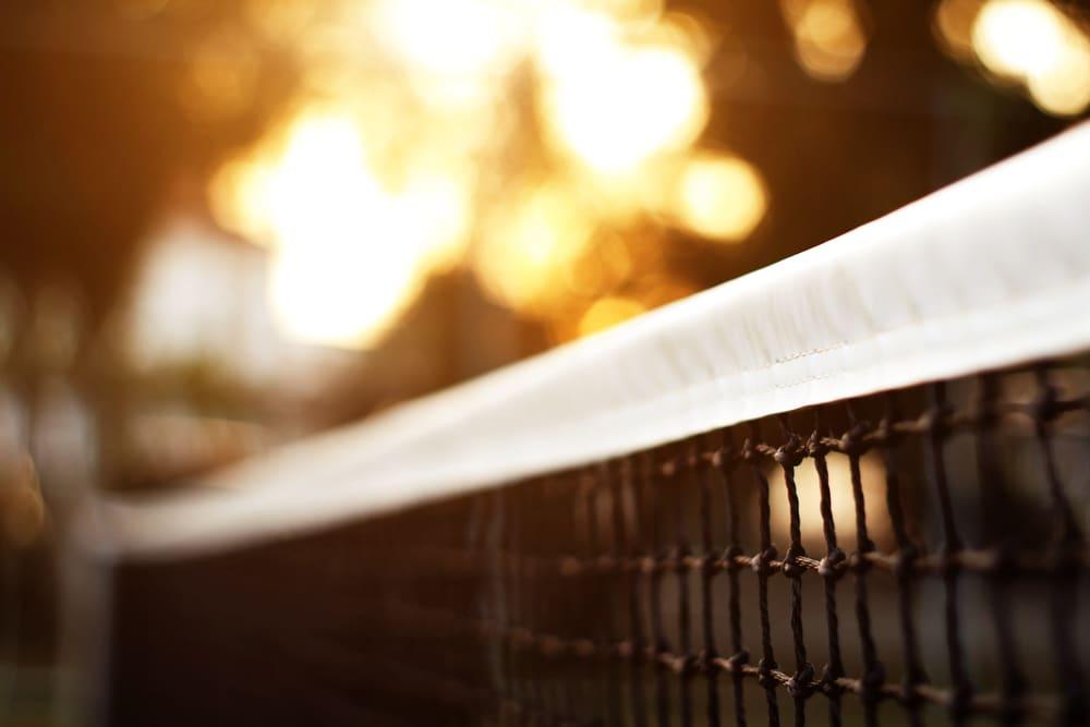 Tennis net headband after repair at recreation center