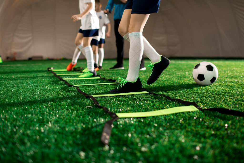 Young soccer players at an indoor sports facility