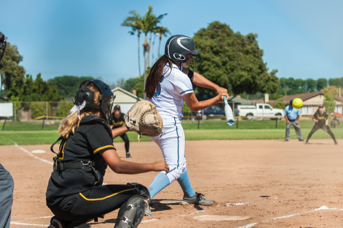 Women playing softball at recreational sports complex.