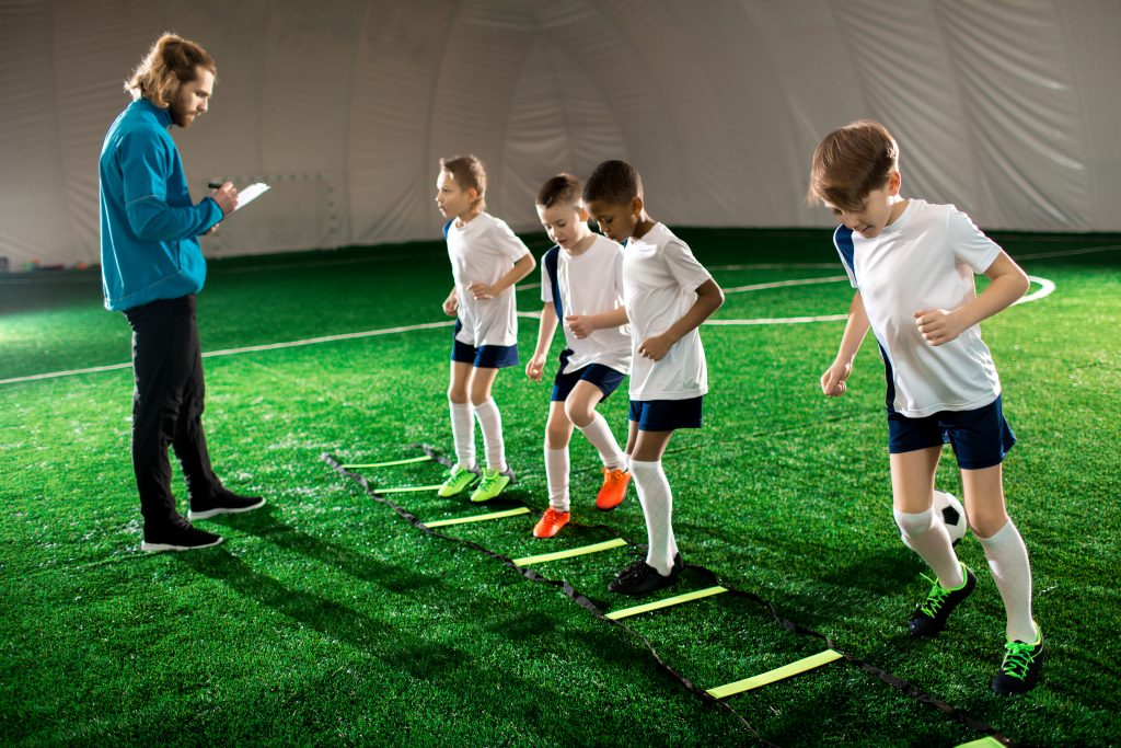 Young soccer players practicing at an indoor sports facility