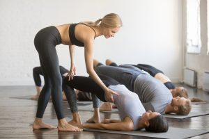 Yoga instructor teaching class