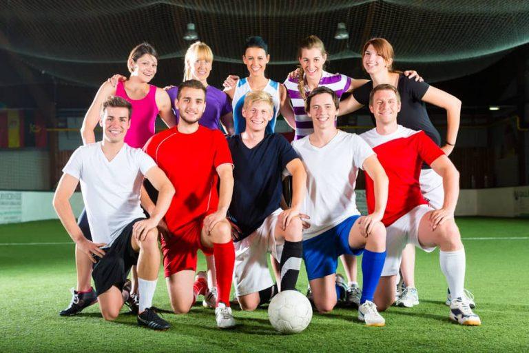 Indoor soccer team posing for camera