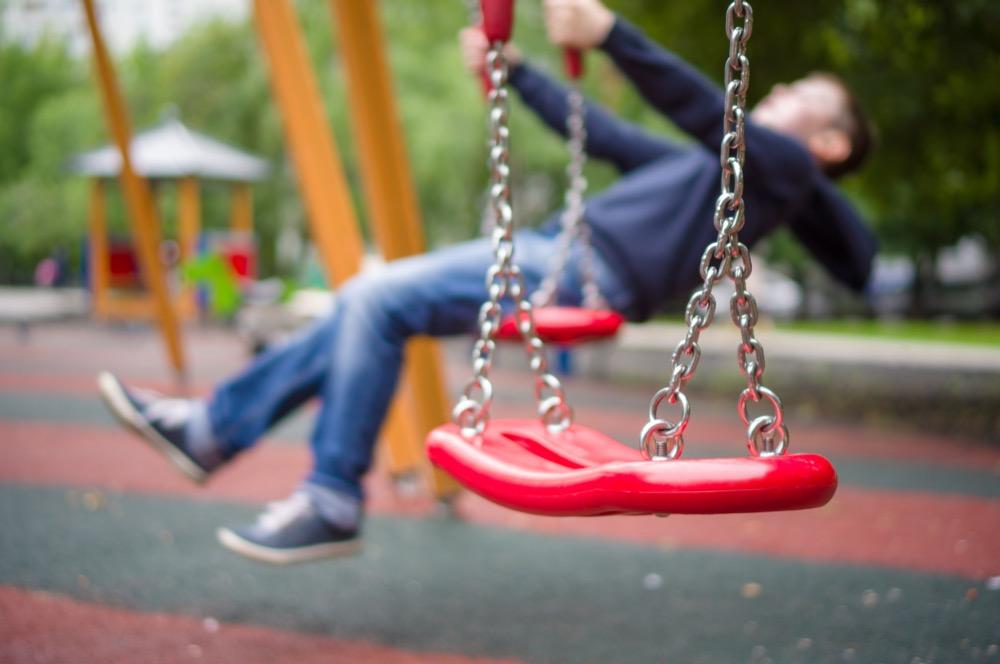 Swing on a swing set in community center