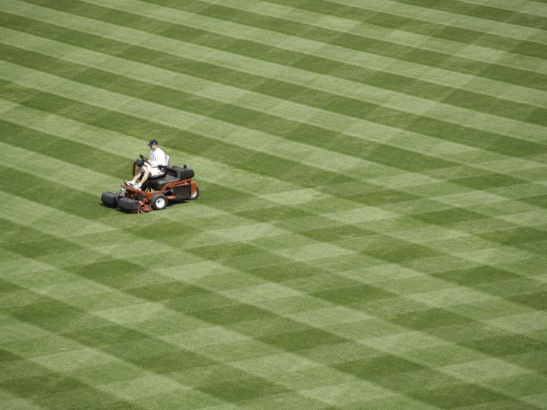 Person mowing baseball field