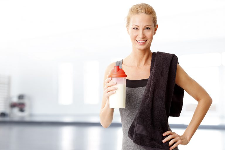 Person holding a protein shake
