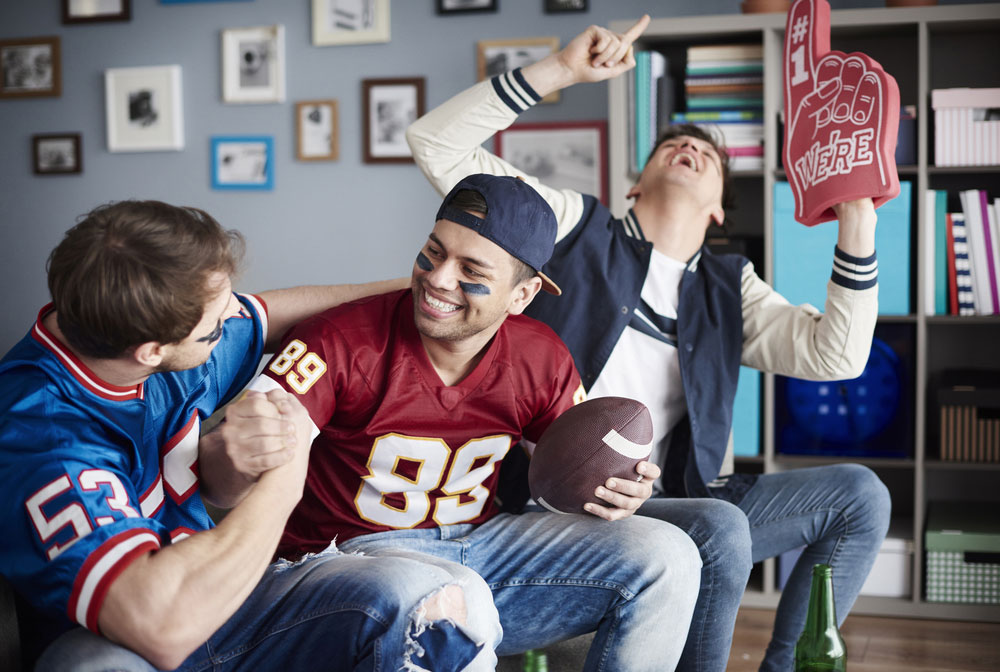 Group of football fans watching a game