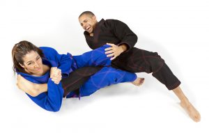 Two people practicing jiu-jitsu submission