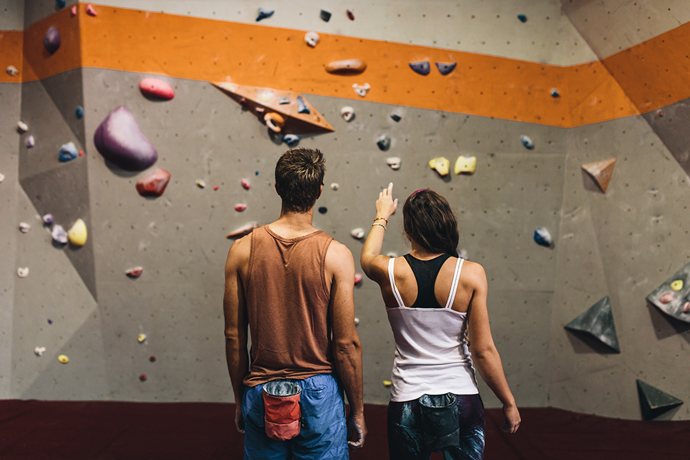 Rock climbing instructor giving tips