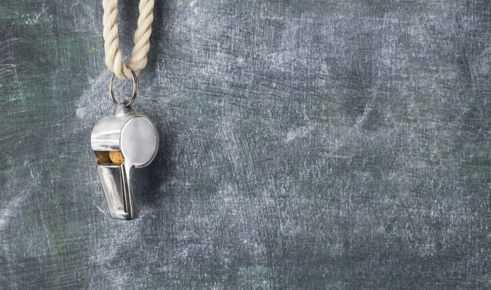 Whistle hanging from a board