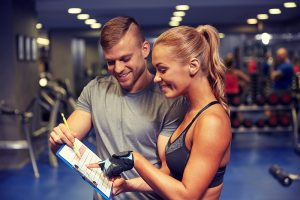Two people creating workout plan