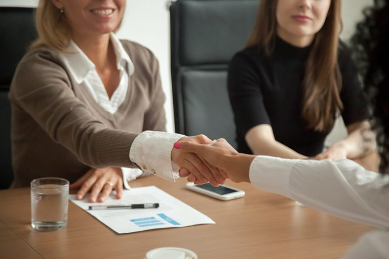 Human Resources Professional Shaking Hands With Applicant