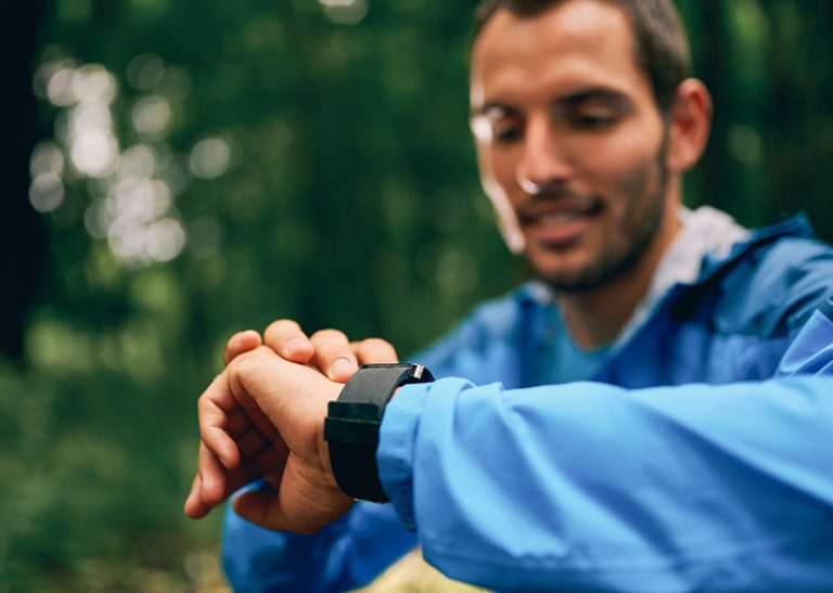 Millennial Jogger Using Smart Watch