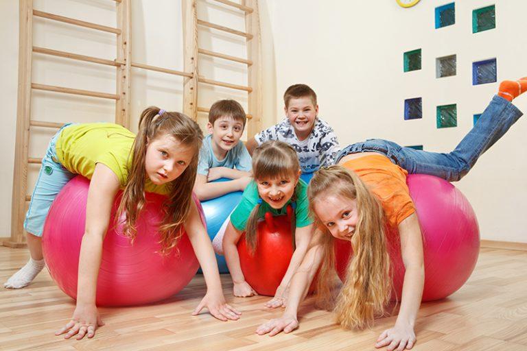 Kids Playing on Gymnastic Balls
