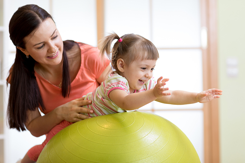 Mother and Toddler on Exercise Ball