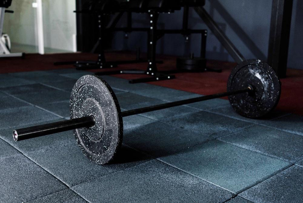 Barbell lying on gym floor