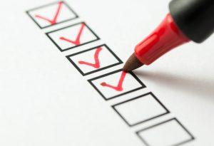 Checklist with red pen.