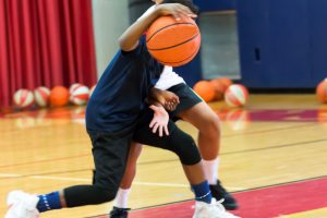 Two teenage basketball players at camp
