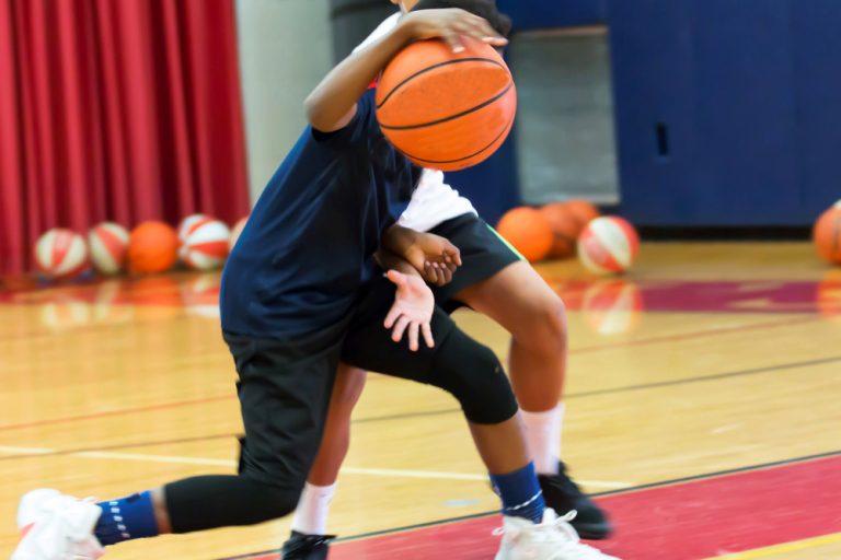 Two teenage basketball players at camp